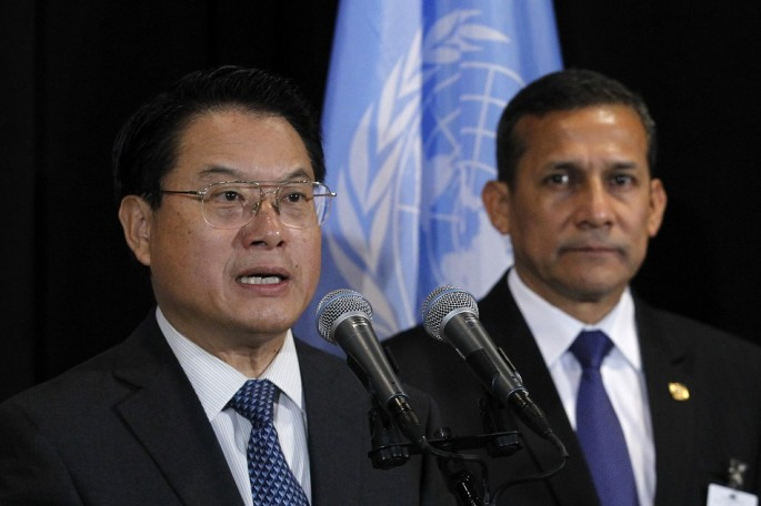 UNIDO director-general Li Yong (L) speaks to the media, while Peruvian President Ollanta Humala listens, following a meeting at the United Nations headquarters in New York, Sept. 23, 2013.