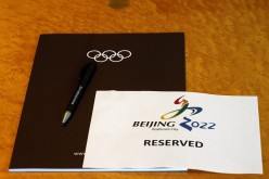 A sign is placed on a table for members of the Beijing 2022 delegation at the start of the Executive Board meeting at the International Olympic Committee (IOC) headquarters in Lausanne, July 7, 2014.