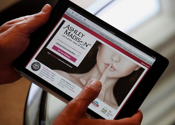 """Life is short. Have an affair,"" Ashley Madison's tagline reads."