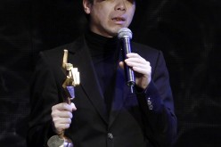 Chinese director Feng Xiaogang receives the Best Top Grossing Film award for the movie