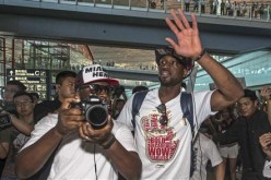 NBA player Dwyane Wade (front R) waves to fans in China.