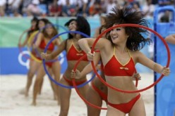 Chinese dancers at the women's preliminary round beach volleyball matches at the Beijing 2008 Olympic Games.