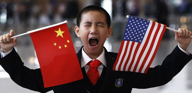 A boy yawns while awaiting Hilary Clinton's arrival in Beijing.