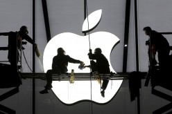 Workers prepare for the opening of an Apple store in Hangzhou, Zhejiang Province, Jan. 23, 2015.