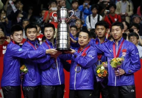 China s historic table tennis champion welcomes a german p - Table tennis world championship 2014 ...