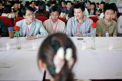 A table of potential Chinese husbands at a dating event in Shanghai.