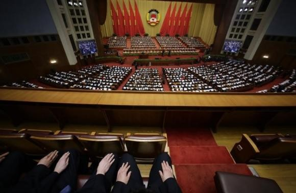 Many people resign from their jobs at the Great Hall of the People after years of working.