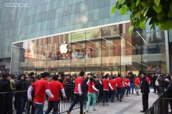 Customers wait in front of the newly opened Apple Store in Shenyang, China.