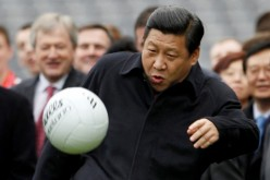 President Xi Jinping kicks a football during a U.K. visit.