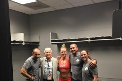 Holly Holm with her coaches