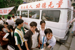 Volunteer blood donors at a mobile laboratory in Chengdu, China.