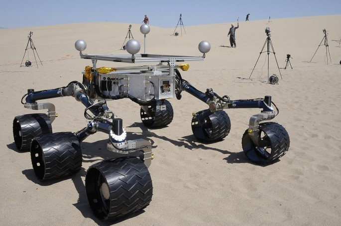 "Members of the Mars Science Laboratory/Curiosity team, which includes rover drivers and scientists, test out an engineering model of its next generation Mars rover, dubbed ""Curiosity"", in the desert near Baker, California May 10, 2012. According to a pres"