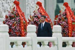 Chinese President Xi Jinping walks during a memorial ceremony.