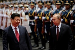 Chinese President Xi Jinping and Russian President Vladimir Putin in a welcome ceremony for a Confidence Building Summit in Shanghai last year.