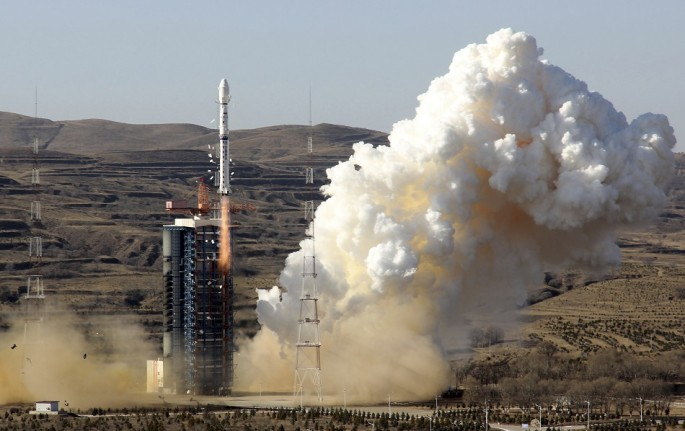A Long March-4B rocket loaded with the CBERS-4 satellite blasts off from its launch pad at the Taiyuan Satellite Launch Center in Taiyuan, Shanxi Province, Dec. 7, 2014.