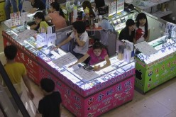 Smartphones and tablets are being sold in booths at a mall in Shenzhen.