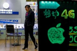 A sales assistant walks inside a China Mobile store in China.