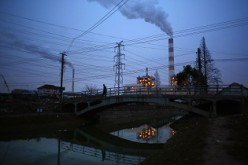 Smoke rises from the chimneys of a thermal power plant in Shanghai.