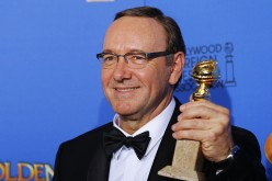 Kevin Spacey poses backstage with his award for Best Performance by an Actor in a Television Series for