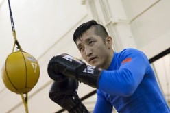 Zou Shiming of China works out in front of the media at the Venetian Macao hotel in Macau, March 5, 2015.