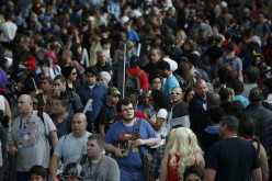 Attendees enter New York's Comic-Con convention, Oct. 9, 2014.