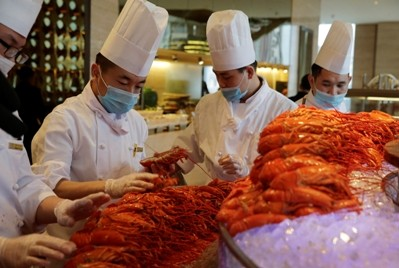 Chinese chefs prepare Boston lobsters at a hotel restaurant in Beijing.
