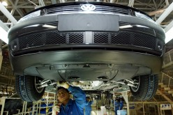 Chinese workers assemble a Volkswagen Passat at Shanghai Volkswagen plant.