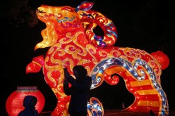Visitors take pictures in front of a goat-shaped lantern ahead of the Lantern Festival in Wuhan, Hubei Province, Feb. 28, 2015.