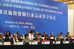 Finance Minister Lou Jiwei together with guests at the signing ceremony of the Asian Infrastructure Investment Bank at the Great Hall of the People in Beijing in October last year.