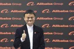 Alibaba founder and chairman Jack Ma poses for the media while touring the CeBIT trade fair in Hannover, March 16, 2015.
