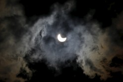 A partial eclipse of the sun is seen through clouds in Sarajevo March 20, 2015.