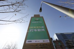 An advertisement of Kuaidi Dache taxi-hailing firm is seen on the exterior of a building in Beijing, Feb. 27, 2014.