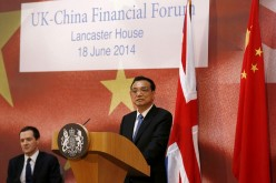 Chinese Premier Li Keqiang addresses delegates at the U.K.-China Financial Forum at Lancaster House in London, June 18, 2014.