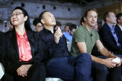 HTC Chairwoman Cher Wang sits with other company officials at a product launch.