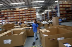 An employee of Mopar's Asia Pacific Regional Parts Distribution Center, operating at the Shanghai Free Trade Zone, works during a government organized media tour, Sept. 24, 2014.