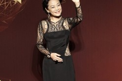 Actress Sylvia Chang waves as she stands on the red carpet at the 51st Golden Horse Film Awards in Taipei, Nov. 22, 2014.