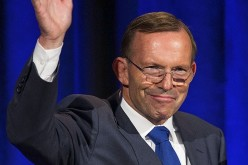 Australian Prime Minister Tony Abbott gestures during a joint news conference during an official two-day visit in Auckland, Feb. 28, 2015.