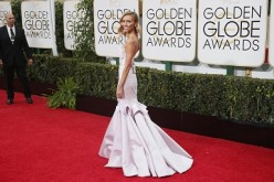 TV personality Giuliana Rancic arrives at the 72nd Golden Globe Awards in Beverly Hills, California January 11, 2015