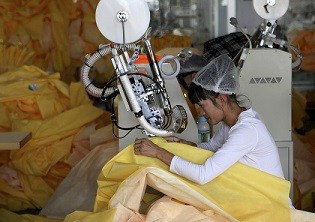 A worker at a factory making protective clothing in Weifang in Shandong Province.