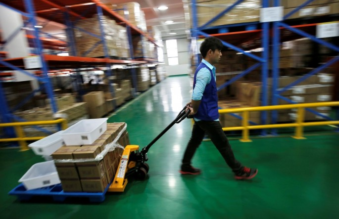 An employee works at an Alibaba warehouse on the outskirts of Hangzhou, Zhejiang Province. China's cabinet recently rolled out several policies to benefit the nation's e-commerce sector.