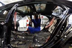 A worker assembles a Mercedes-Benz S-class model.