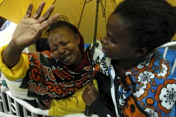 A woman reacts after seeing her son who was rescued from the Garissa University attack