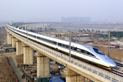 A high-speed train traveling to Guangzhou as seen running on Yongdinghe Bridge in Beijing.
