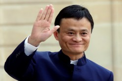 Alibaba founder and chairman Jack Ma waves to onlookers during a meeting with French President Francois Hollande in Paris, March 18, 2015.