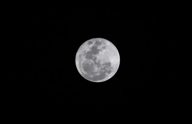 The full moon as seen over Lagos December 17, 2013. The last full moon of the year is the smallest too as the moon is at its most distant point from the earth's orbit, a phenomenon known as apogee