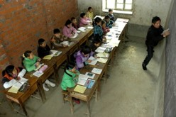 Students attend class at a village on the outskirts of Baokang, in central China's Hubei Province.