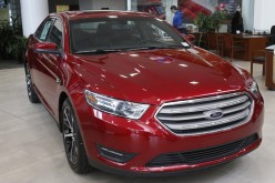 A 2015 red Ford Taurus sedan is seen in the showroom at the Suburban Ford dealership in Sterling Heights, Michigan, Feb. 6, 2015.