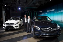 Mercedes-Benz USA officials Wolf-Dieter Kurz (L) and Stephen Cannon present the new Mercedes-Benz GLE 550 e 4MATIC and the new GLE 35 4MATIC at the 2015 New York International Auto Show in New York.