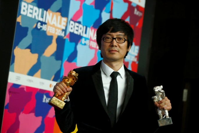 "Diao Yinan, director of ""Black Coal, Thin Ice,"" poses during a news conference after the awards ceremony of the 64th Berlinale International Film Festival in 2014."