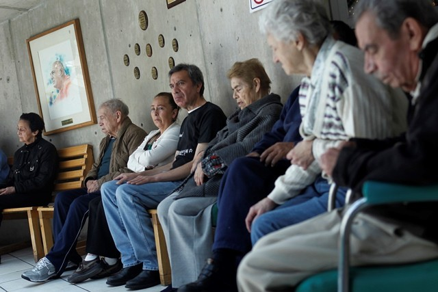 Patients with Alzheimer's and dementia are sit inside the Alzheimer foundation in Mexico City April 19, 2012.